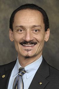Dr.  Peter J. Delfyett