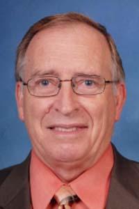 Dr.  James E. Harvey